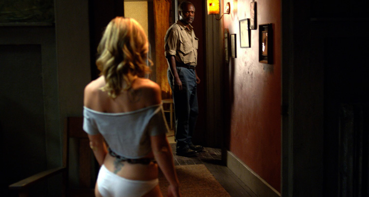 Black Snake Moan 2007 Movie Christina Ricci in white panties and top looking at Samuel L. Jackson in the hallway scene