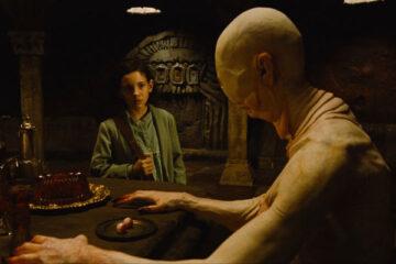 El Laberinto del Fauno 2006 Movie Ivana Baquero as Ofelia looking at the skinny creature known as the Pale man