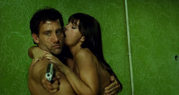 Shoot Em Up 2007 Movie Scene Clive Owen as Smith holding a gun and having sex with Monica Bellucci as Donna at the same time