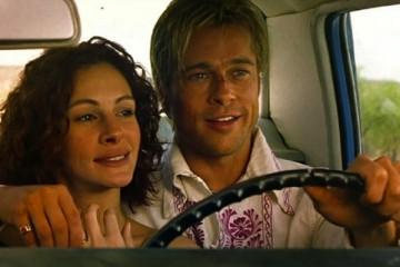 The Mexican 2001 Movie Brad Pitt as Jerry Welbach driving a car and hugging Julia Roberts as Samantha Barzel