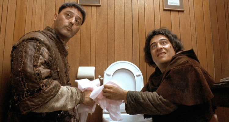 Les Visiteurs 1993 Movie Christian Clavier as Jacquard and Jean Reno as Godefroy in the bathroom drinking water from the toilet