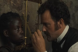 Man to Man 2005 Movie Hugh Bonneville measuring the skull of the pygmy they have captured in his cell scene