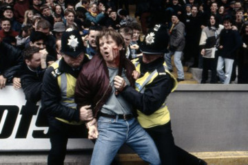 ID 1995 Movie Reece Dinsdale with a bloody cheek getting carried away by two policeman at the stadium after an incident