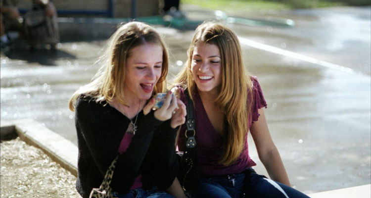 Thirteen 2003 Movie Nikki Reed as Evie Zamora and Evan Rachel Wood as Tracy Freeland looking at new tongue piercing in a mirror and laughing