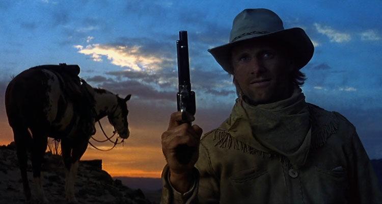 Hidalgo 2004 Movie Viggo Mortensen holding a gun with a horse in the background