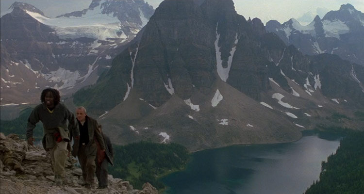The Edge 1997 Movie Anthony Hopkins, Alec Baldwin and Harold Perrineau climbing a mountain