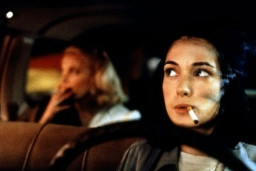 Night on Earth 1991 Movie Winona Ryder as Corky smoking a cigarette with Gena Rowlands doing the same in the backseat of the taxi