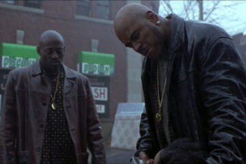 In Too Deep 1999 Movie Omar Epps and LL Cool J as God standing in the street in rain holding a gun to a head of snitch