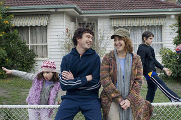 My Year Without Sex 2009 Scene Sacha Horler as Natalie and Matt Day as Ross standing in front of their house smiling