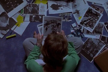 Apt Pupil 1998 Movie Scene Brad Renfro as Todd Bowden looking at pictures of Nazi crimes
