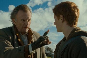 Under the Mountain 2009 Movie Scene Sam Neill as Mr. Jones talking to Tom Cameron as Theo