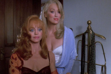 Death Becomes Her 1992 Movie Scene Meryl Streep as Madeline Ashton Menville and Goldie Hawn as Helen Sharp in revealing dresses offering a drink to Bruce Willis as Dr. Ernest Menville