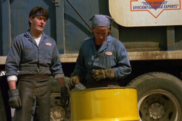 Men At Work 1990 Movie Scene Charlie Sheen as Carl Taylor and Emilio Estevez as James St. James finding something while they're loading up garbage