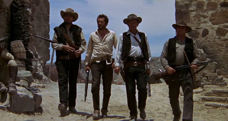 The Wild Bunch 1969 Movie Scene William Holden as Pike, Ernest Borgnine as Dutch, Warren Oates as Lyle Gorch and Ben Johnson as Tector Gorch walking into town holding rifles