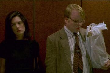 Happiness 1998 Movie Scene Lara Flynn Boyle as Helen Jordan and Philip Seymour Hoffman as Allen riding in an elevator