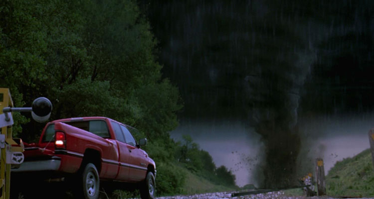 Twister [1996] Movie Red truck towing a tornado monitoring device in front of a huge twister scene