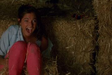 Critters 1986 Movie Scene Nadine Van der Velde as April Brown screaming in the barn as she sees the little monsters