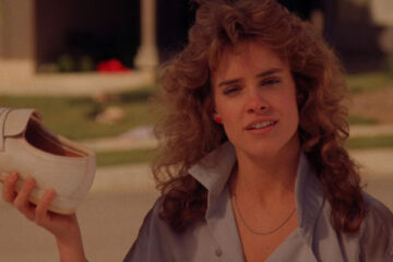 Night of the Comet 1984 Movie Scene Catherine Mary Stewart as Regina Reggie Belmont holding a shoe full of red dust