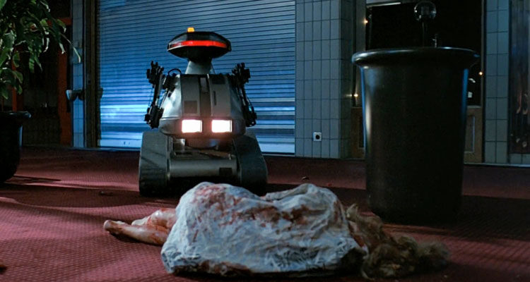 Chopping Mall 1986 Movie Scene A killer robot known as Killbot standing over the dead body of a girl who he just killed