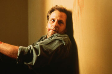 Chasing Sleep 2000 Movie Scene Jeff Daniels as Ed Saxon sitting in hallway with an empty glare in his eyes after suffering from insomnia for a few days