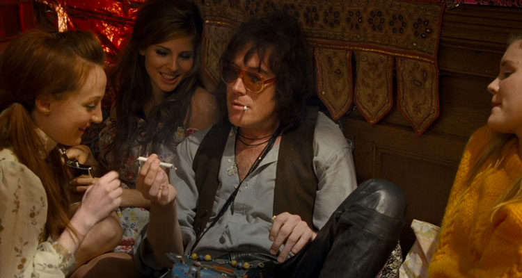 Mr Nice 2010 Movie Scene Rhys Ifans as Howard Marks smoking a joint with a couple of girls