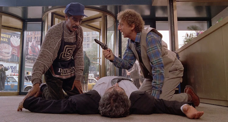 See No Evil Hear No Evil 1989 Movie Richard Pryor as Wally and Gene Wilder as Dave standing over a dead body in front of their shop