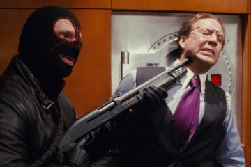 Trespass 2011 Movie Scene Nicolas Cage as Kyle Miller with a shotgun pointed at his head by a robber
