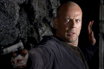 Hostage 2005 Movie Scene Bruce Willis as Jeff Talley holding a gun and leaning on a wall