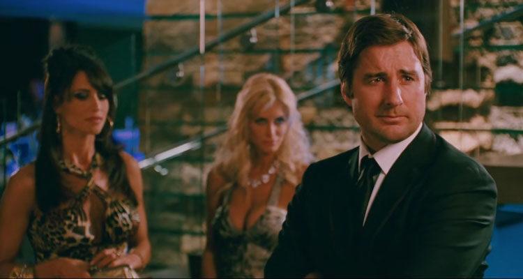 Middle Men 2009 Movie Scene Luke Wilson as Jack Harris with two sexy ladies behind him