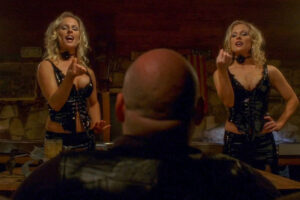 Drop Dead Sexy 2005 Movie Diane and Elaine Klimaszewski as the hot and sexy twins eating cherries in front of Pruitt Taylor Vince