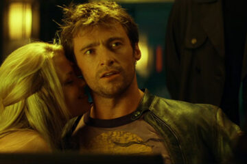 Swordfish 2001 Movie Hugh Jackman looking at Travolta as a pretty blonde is licking his neck