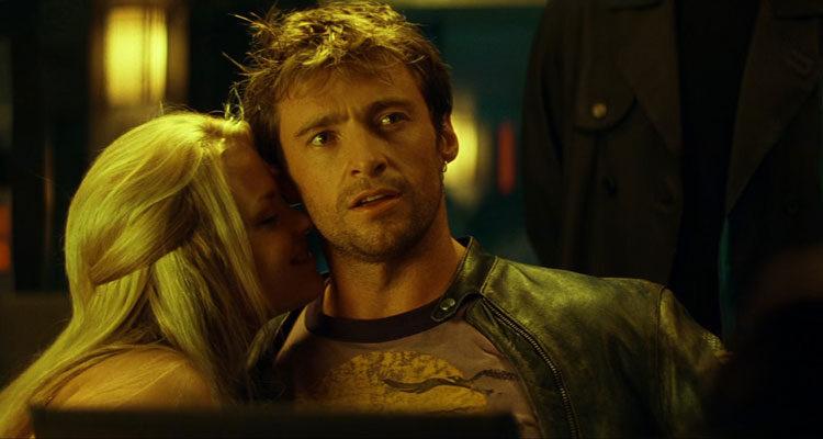 Swordfish 2001 Movie Hugh Jackman looking at Travolta as a pretty blonde is licking his neck