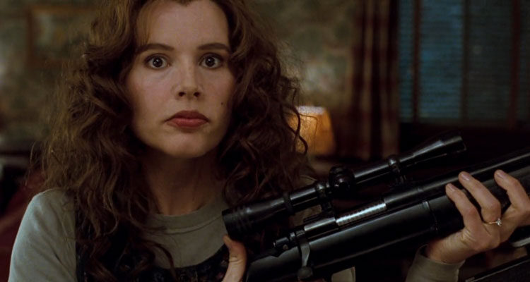 The Long Kiss Goodnight 1996 Movie Scene Geena Davis as Samantha Caine (Charly) holding a sniper rifle she just assembled