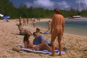 Along Came Polly 2004 Movie Ben Stiller and Debra Messing laying on their towels when a naked scuba instructor with his ass showing played by Hank Azaria approaches them scene