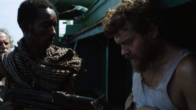 A Hijacking AKA Kapringen [2012] Movie Pilou Asbæk being taken outside the ship by the somali pirates scene