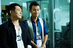 Badges of Fury [2013] Movie Jet Li and Zhang Wen as detectives in the building listening to a briefing