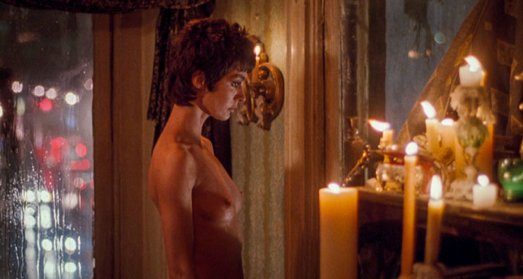Innocent Blood 1992 Movie Scene Anne Parillaud as Marie standing naked in a candlelit room and looking into the night