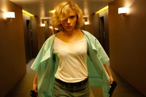 Lucy [2014] Movie Scarlett Johansson holding two guns and walking down the hallway scene