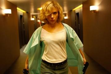 Lucy [2014] Movie Scarlett Johansson holding two guns and walking down the hallway scene