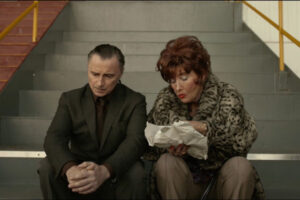 The Legend of Barney Thomson 2015 Movie Scene Robert Carlyle as Barney Thomson and Emma Thompson as Cemolina eating fish and chips at the dog racetrack