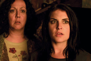 Housebound 2014 movie Morgana O'Reilly as Kylie Bucknell and Rima Te Wiata as Miriam Bucknell looking in horror scene