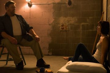 10 Cloverfield Lane 2016 Movie Mary Elizabeth Winstead as Michelle and John Goodman as Howard first scene in the basement