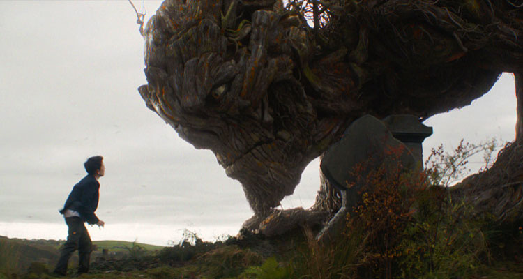 A Monster Calls 2016 Movie Lewis MacDougall as Conor talking to a giant tree monster