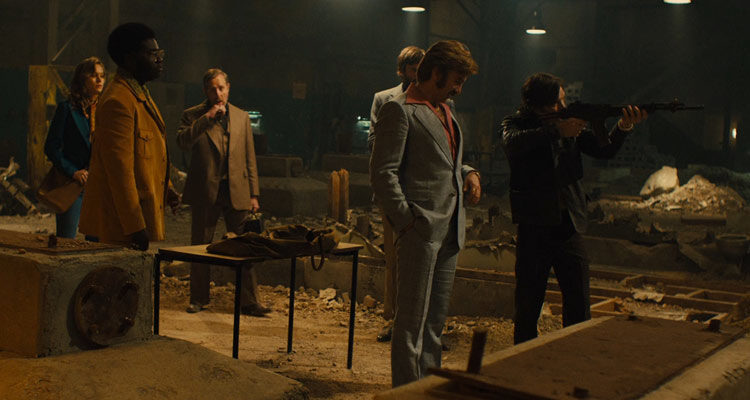 Free Fire 2016 Movie Cillian Murphy as Chris testing weapons in the warehouse scene