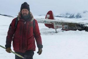 Arctic 2018 Movie Mads Mikkelsen as Overgård coming off his crashed plane