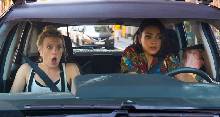The Spy Who Dumped Me 2018 Mila Kunis as Audrey and Kate McKinnon as Morgan driving a car in a car chase