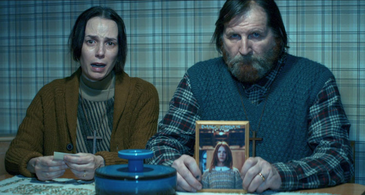 The Girl in the Fog 2017 Movie Parents holding Anna's picture