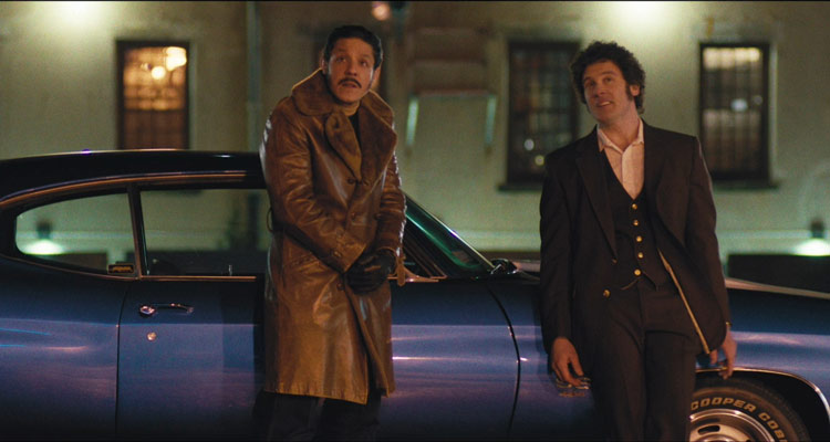 Vault 2019 Movie Scene 2 Theo Rossi and Clive Standen next to their car