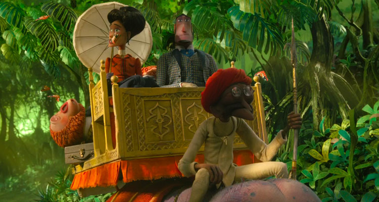Missing Link 2019 Hugh Jackman as Sir Lionel Frost and Zoe Saldana as Adelina Fortnight riding an elephant on their way to Shangri-La