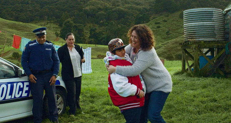 Hunt For The Wilderpeople 2016 Movie Rima Te Wiata hugging Julian Dennison